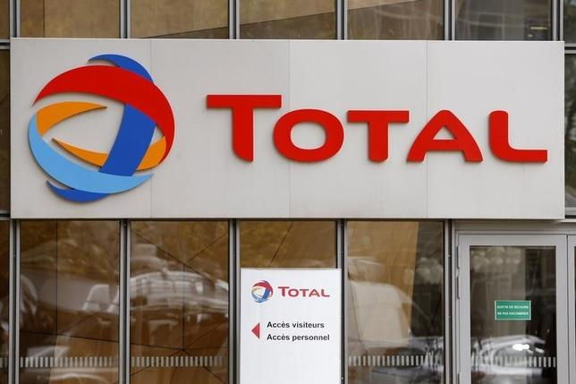 The logo of French oil giant Total is seen at its headquarters in the financial and business district of la Defense in Courbevoie near Paris October 21, 2014.   REUTERS/Charles Platiau