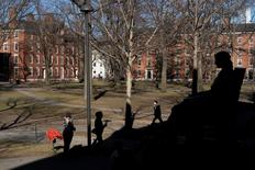 A statue of John Harvard looks over Harvard Yard at Harvard University in Cambridge, Massachusetts January 20, 2015.  REUTERS/Brian Snyder