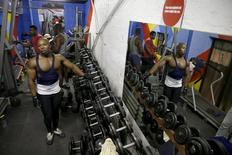 Lwandile Futshane is reflected in a mirror as he takes a break during his training session at a township gym in Johannesburg's Alexandra township, South Africa March 29, 2016. REUTERS/Siphiwe Sibeko