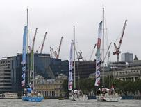 Clipper 70 yachts participating in the Clipper Round the World Yacht Race sail down the Thames in London, August 30, 2015. The race will cover 40,000 nautical miles. REUTERS/Eddie Keogh