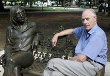 Former Beatles producer Sir George Martin visits a sculpture of John Lennon in a Havana park named after the musician, in this October 30, 2002 file photo. REUTERS/Rafael Perez/Files