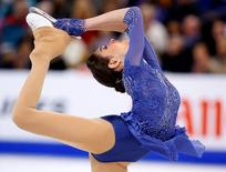 Apr 2, 2016; Boston, MA, USA; Evgenia Medvedeva of Russia competes during her gold medal performance in the ladies free skate at the ISU World Figure Skating Championships at TD Garden. Mandatory Credit: Winslow Townson-USA TODAY Sports