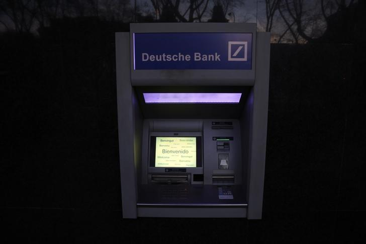 An ATM is seen outside a branch of German Deutsche Bank in Madrid, Spain, March 22, 2016. REUTERS/Sergio Perez