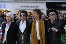 """Members of the Rolling Stones (L-R) Charlie Watts, Ronnie Wood, Mick Jagger and Keith Richards arrive for the """"Exhibitionism"""" opening night gala at the Saatchi Gallery in London, Britain April 4, 2016. REUTERS/Luke MacGregor"""