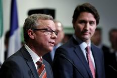 Saskatchewan Premier Brad Wall (L) speaks during a news conference with Canada's Prime Minister Justin Trudeau at the First Ministers' meeting in Ottawa, Canada November 23, 2015. REUTERS/Chris Wattie