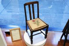 """A chair used by British author J.K. Rowling while writing """"Harry Potter and the Sorcerer's Stone"""" and """"Harry Potter and the Chamber of Secrets"""" is shown in the window of Heritage Auctions in New York April 4, 2016.  REUTERS/Lucas Jackson -"""