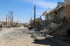 Разрушенные дома в городе Талят аль-Исс. Сирийская армия и союзники ночью осуществили крупную атаку против боевиков к югу от Алеппо, названную самым мощным наступлением правительственных сил в этом районе после вступления в силу соглашения о прекращении враждебных действий в феврале. REUTERS/Ammar Abdullah