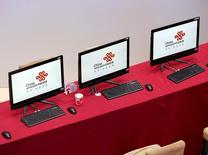 Компьютерные мониторы в  медиацентре Пекина. Расходы на информационные технологии по всему миру могут пострадать в текущем году от неопределенности мировой экономики, сообщила исследовательская компания Gartner Inc в четверг.  REUTERS/Kim Kyung-Hoon