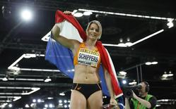 Dafne Schippers of the Netherlands celebrates her silver medal finish in the women's 60 meters final during the IAAF World Indoor Athletics Championships in Portland, Oregon March 19, 2016. Picture taken March 19, 2016. REUTERS/Lucy Nicholson - RTSBCV6