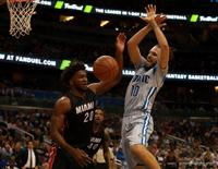 Apr 8, 2016; Orlando, FL, USA; Miami Heat forward Justise Winslow (20) steals the ball form Orlando Magic guard Evan Fournier (10) during the second half at Amway Center. Orlando Magic defeated the Miami Heat 112-109. Mandatory Credit: Kim Klement-USA TODAY Sports