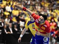 Spain's Valero Rivera scores during the men's handball Olympic Qualification Tournament match between Sweden and Spain at Malmo Arena in Malmo, Sweden, April 10, 2016. REUTERS/Emil Langvad/TT News Agency