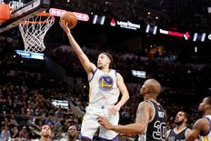 Apr 10, 2016; San Antonio, TX, USA; Golden State Warriors shooting guard Klay Thompson (11) shoots the ball as San Antonio Spurs power forward David West (30) looks on during the second half at AT&T Center. Soobum Im-USA TODAY Sports