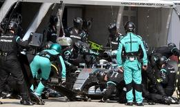 Mercedes Formula One driver Lewis Hamilton of Britain takes his car in for a pit-stop during the Chinese F1 Grand Prix at the Shanghai International Circuit, April 12, 2015. REUTERS/Goh Chai Hin/Pool