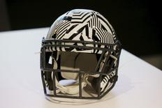 A new impact absorbing helmet is displayed at the NFL Headquarters in New York December 3, 2015.  REUTERS/Brendan McDermid