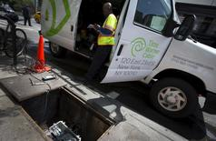 A Time Warner Cable service technician works on cable service from a van parked on the Upper West side of the Manhattan borough of New York City, May 26, 2015. REUTERS/Mike Segar