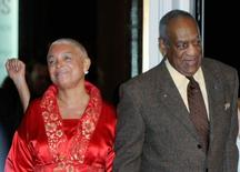 Comedian Bill Cosby and his wife Camille (L) arrive at the Kennedy Center For the Performing Arts for the Mark Twain Prize for American Humor ceremony in Washington in this October 26, 2009 file photo. REUTERS/Mike Theiler/Files