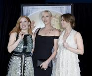 """Cast members Jessica Chastain (L), Charlize Theron (C) and Emily Blunt pose during the premiere of the film """"The Huntsman: Winter's War"""" in Los Angeles, California, April 11, 2016. REUTERS/Kevork Djansezian"""