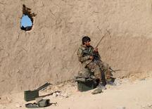 An Afghan National Army (ANA) soldier speaks on a radio at an outpost in Helmand province, Afghanistan in this December 20, 2015 file photo.  REUTERS/Abdul Malik/Files