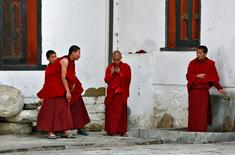 A monk looks at his mobile phone in Tashichho Dzong, the seat of the head of Bhutan's Civil Government in Thimphu, Bhutan April 13, 2016  REUTERS/Cathal McNaughton