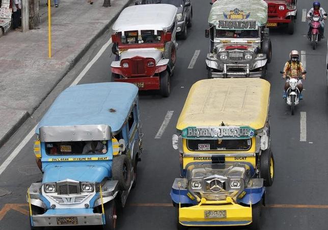 Public transport jeepneys, using diesel fuel, are seen plying on a road in Paranaque, Metro Manila March 2, 2016.   REUTERS/Erik De Castro/Files