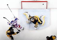 New York Rangers center Derick Brassard (16) celebrates after scoring a goal against Pittsburgh Penguins goalie Jeff Zatkoff (37) during the second period in game two of the first round of the 2016 Stanley Cup Playoffs at the CONSOL Energy Center. The Rangers won 4-2. Mandatory Credit: Charles LeClaire-USA TODAY Sports