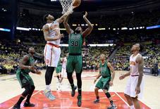 Apr 16, 2016; Atlanta, GA, USA; Atlanta Hawks forward Mike Scott (32) goes up for a shot against Boston Celtics  forward Amir Johnson (90) during the second half in game one of the first round of the NBA Playoffs at Philips Arena. Mandatory Credit: John David Mercer-USA TODAY Sports