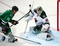 Apr 16, 2016; Dallas, TX, USA; Dallas Stars left wing Jamie Benn (14) scores the game winning goal against Minnesota Wild goalie Devan Dubnyk (40) during the third period of game two of the first round of the 2016 Stanley Cup Playoffs at the American Airlines Center. The Stars defeat the Wild 2-1. Mandatory Credit: Jerome Miron-USA TODAY Sports
