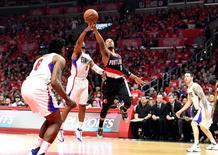 Apr 17, 2016; Los Angeles, CA, USA; Portland Trail Blazers guard Damian Lillard (0) shoots against Los Angeles Clippers guard Chris Paul (3) during the first half in game one of the first round of the NBA Playoffs at Staples Center. Richard Mackson-USA TODAY Sports
