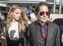 Actor Johnny Depp (R) and wife Amber Heard arrive at the Southport Magistrates Court on Australia's Gold Coast, April 18, 2016.    REUTERS/Dave Hunt/AAP