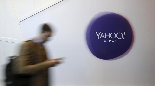 A man walks past a Yahoo logo during the Mobile World Congress in Barcelona, Spain in this February 24, 2016 file photo. REUTERS/Albert Gea/Files