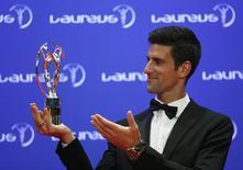 Tennis player Novak Djokovic of Serbia poses with his Laureus World Sportsman of the Year award during the Laureus World Sports Awards 2016 in Berlin, Germany, April 18, 2016.  REUTERS/Hannibal Hanschke