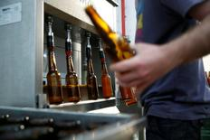 An employee works at Herzl Brewery which produced a craft beer from wheat that Tel Aviv University geneticists identified as the strain used for beer in the Holy Land two millennia ago, in Jerusalem April 18, 2016. REUTERS/Ronen Zvulun