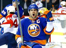 New York Islanders center John Tavares (91) celebrates after scoring a power play goal against the Florida Panthers during the second period of game four of the first round of the 2016 Stanley Cup Playoffs against the Florida Panthers at Barclays Center. Mandatory Credit: Andy Marlin-USA TODAY Sports