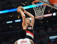 Portland Trail Blazers center Mason Plumlee (24) dunks to score a basket  against Los Angeles Clippers during the first half at Staples Center. Mandatory Credit: Gary A. Vasquez-USA TODAY Sports