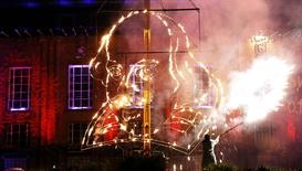A pyrotechnician lights a flaming depiction of William Shakespeare during a firework display at the Royal Shakespeare Company marking the 450th anniversary of Shakespeare's birth in Stratford-upon-Avon, in this file photograph dated April 23, 2014.  REUTERS/Suzanne Plunkett/files