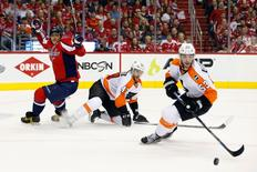 Apr 22, 2016; Washington, DC, USA; Philadelphia Flyers defenseman Shayne Gostisbehere (53) skates with the puck past Washington Capitals left wing Alex Ovechkin (8) in the first period in game five of the first round of the 2016 Stanley Cup Playoffs at Verizon Center. Mandatory Credit: Geoff Burke-USA TODAY Sports
