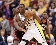 Apr 23, 2016; Indianapolis, IN, USA; Indiana Pacers center Ian Mahinmi (28) defended by Toronto Raptors center Bismack Biyombo (8) during the second half of game four of the first round of the 2016 NBA Playoffs at Bankers Life Fieldhouse. Indiana defeats Toronto 100-83. Mandatory Credit: Brian Spurlock-USA TODAY Sports