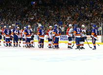 The New York Islanders are congratulated by the the Florida Panthers during the ceremonial handshake line after defeating the Panthers in double overtime in game six of the first round of the 2016 Stanley Cup Playoffs at Barclays Center. The Islanders defeated the Panthers 2-1 to win the series four games to two. Mandatory Credit: Andy Marlin-USA TODAY Sports
