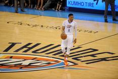 Oklahoma City Thunder guard Russell Westbrook (0) brings the ball up the court against the Dallas Mavericks during the second quarter in game five of the first round of the NBA Playoffs at Chesapeake Energy Arena. Mandatory Credit: Mark D. Smith-USA TODAY Sports