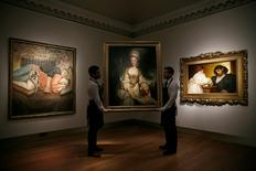 Gallery assistants pose with the paintings (L-R) 'Ib and Her Husband' by Lucian Freud, 'Portrait of Lucy Long, Mrs George Hardinge' by Joshua Reynolds and 'Golden Hours' by Frederic Leighton during a media preview of a Curated Evening Sale and Loan Exhibition Spanning 4 Centuries of British Art at Christie's in London, Britain April 28, 2016. REUTERS/Stefan Wermuth