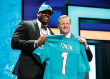 Apr 28, 2016; Chicago, IL, USA; Laremy Tunsil (Mississippi) with NFL commissioner Roger Goodell after being selected by the Miami Dolphins as the number thirteen overall pick in the first round of the 2016 NFL Draft at Auditorium Theatre. Kamil Krzaczynski-USA TODAY Sports