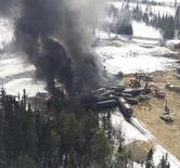 Smoke rises from fires caused by the derailment of a CN Railway train carrying crude oil near the northern Ontario community of Gogama, Ontario in this March 8, 2015 handout photo obtained by Reuters March 9.  REUTERS/MPP Glenn Thibeault/Handout via Reuters