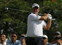 Darren Clarke of Northern Ireland tees off on the 18th hole during the first round of the SMBC Singapore Open golf tournament at Sentosa's Serapong golf course in Singapore January 28, 2016. REUTERS/Edgar Su