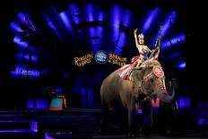 """A performer waves as she rides an elephant during a performance in Ringling Bros and Barnum & Bailey Circus' """"Circus Extreme"""" show at the Mohegan Sun Arena at Casey Plaza in Wilkes-Barre, Pennsylvania, U.S., April 29, 2016. REUTERS/Andrew Kelly"""