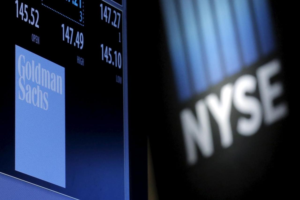 Goldman targets mass affluent borrowers with unusual lending plan a screen displays the ticker symbol and information for goldman sachs on the floor of the new york stock exchange nyse february 9 2016 biocorpaavc Images