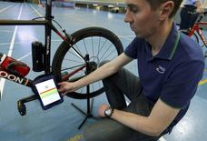Johan Kucaba, Equipment Coordinator at UCI holds a tablet using magnetic resonance technology to detect a bike equipped with a motor during a media event at the Union Cycliste Internationale (UCI) in Aigle, Switzerland May 3, 2016. REUTERS/Denis Balibouse