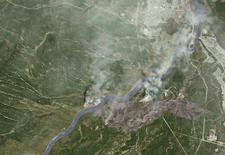 Smoke from wildfires near Fort McMurray, Alberta, Canada are shown in this satellite photo from NASA taken May 3, 2016.  Courtesy NASA/Handout via REUTERS