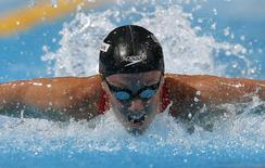 Dana Vollmer of the U.S. swims in the women's 100m butterfly semi-final during the World Swimming Championships at the Sant Jordi arena in Barcelona July 28, 2013. REUTERS/Albert Gea/Files