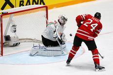 Ice Hockey - 2016 IIHF World Championship - Group B - Hungary v Canada - St. Petersburg, Russia - 8/5/16 - Zoltan Hetenyi of Hungary in action with Corey Perry of Canada. REUTERS/Maxim Zmeyev