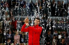 Tennis - Madrid Open - Men's Finals - Novak Djokovic of Serbia v Andy Murray of Britain - Madrid, Spain - 8/5/16 Djokovic holds up the trophy. REUTERS/Paul Hanna